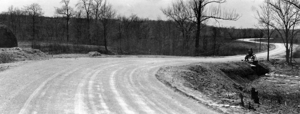 Project #250, Master Project #2784 District 6: Project #250, now a part of Master Project #2784, provided for the reconstruction of 4 miles of the Route Road and the Ferman Road in Jefferson County. View showing completed base course just prior to application of wearing surface, photographed April 13, 1936