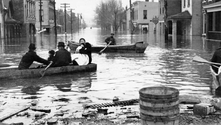 1937 Flood. Evacuating a family at Newport, KY. WPA boat bringing in a marooned family at Newport, KY. View photographed January 27, 1937