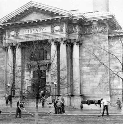 1937 Flood. Repair and clean-up work. WPA men cleaning the walks, drives and lawn of the Louisville Free Public Library at Fourth and York streets. View was photographed February 4, 1937