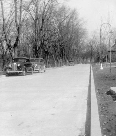 Project #85 District 4: Constructing new pavement on campus at Eastern State Teachers College in Richmond, KY. View of a section of the completed pavement. Photographed February 28, 1936