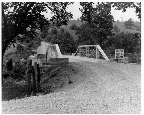 Small, steel. roadway bridge with WPA sign