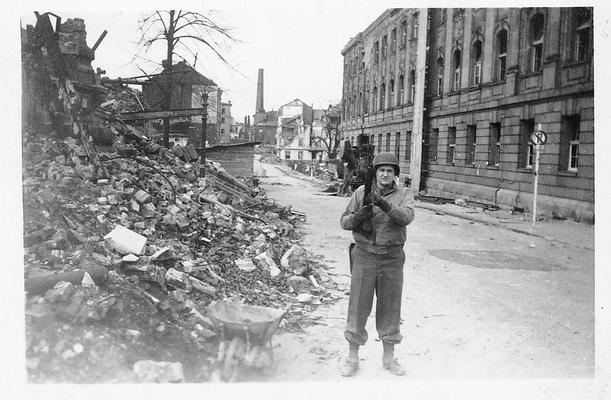 Verviers, Belgium, May, 1945;one GI cameraman on a street filled with rubble