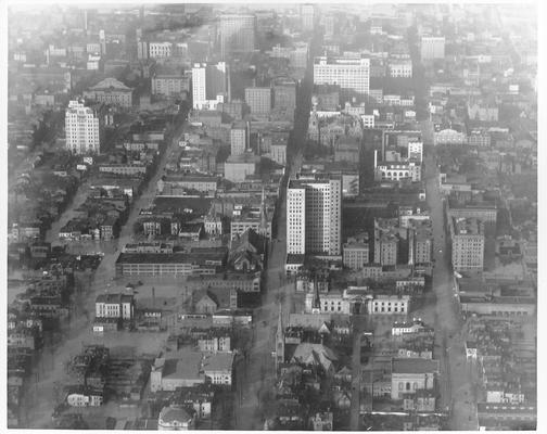 Downtown Louisville area; in the center can be seen the Heyburn Building with the Louisville Free Public Library just this side.  Photo made looking in 4th Avenue, 1/27/37