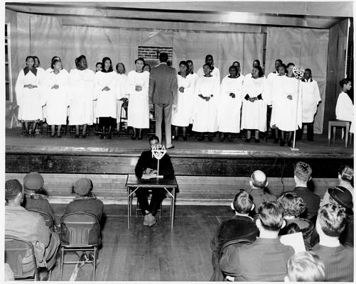 WPA colored teacher trains chorus