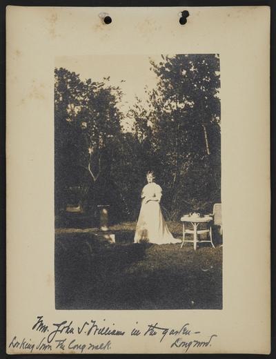 Mrs. John S. Williams in the garden- Longwood, Looking down the long walk