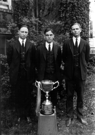 Three young men with trophy