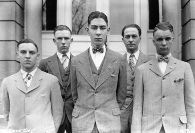 Unidentified individuals from Cave City, Kentucky visiting the University, standing in front of Miller Hall