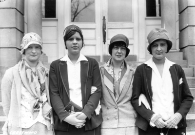 Unidentified individuals from Crestwood, Kentucky visiting the University, standing in front of Miller Hall