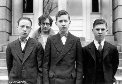 Unidentified high school students from Lexington, Kentucky visiting the University, standing in front of Miller Hall