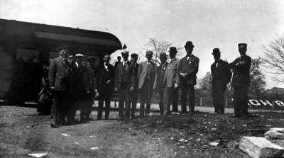 Chattanooga trip, unidentified group standing by train car