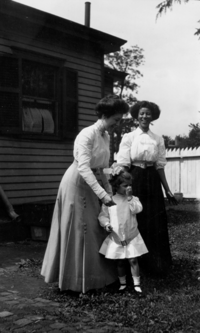 Little girl and two women, one African-American