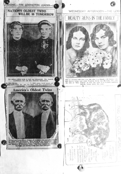 Display of newspaper clippings of twins