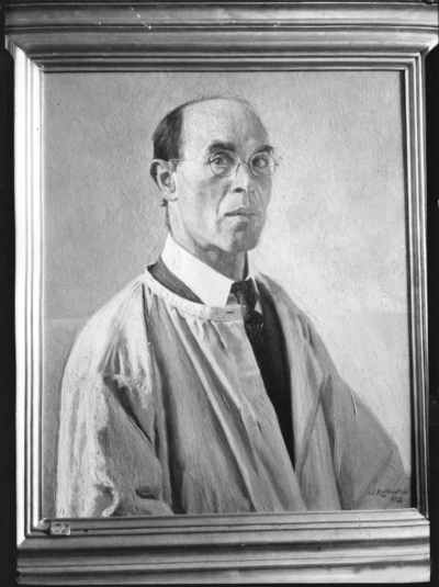 Portrait of man wearing glasses and robe over a suit