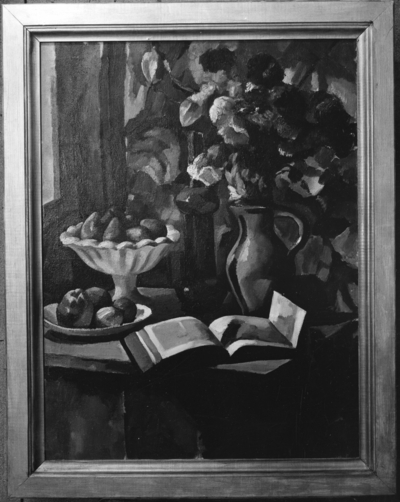 Still life of flowers in vase, fruits, pitcher and book displayed on table