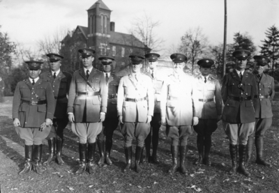 Military officers, Barker Hall in the background