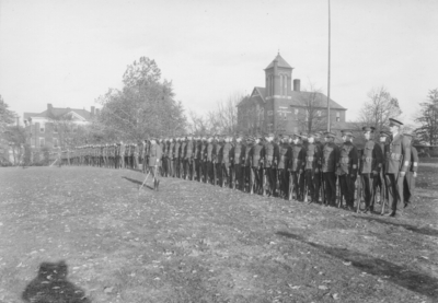 Military unit at attention, Barker Hall in background