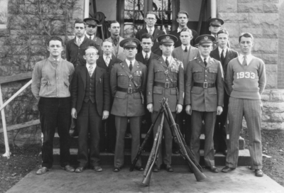 Officers standing with group of men