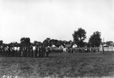 Men in formation with rifles