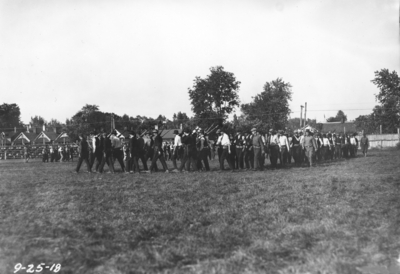 Men marching with rifles