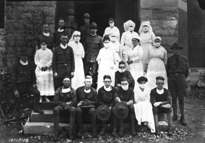 Nurses, Captain Royden, and medical officers; nurses in Gymnasium Hospital During influenza epidemic