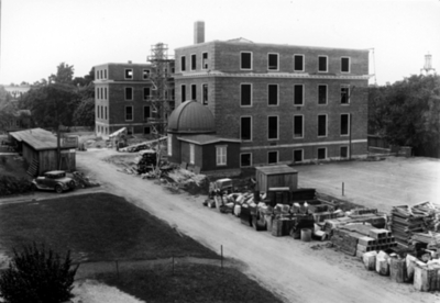 Construction of McVey Hall with the first observatory (wooden) on campus