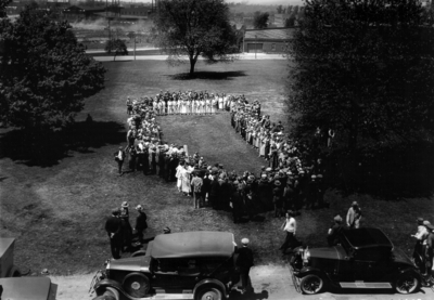 People forming circle in front of Administration building