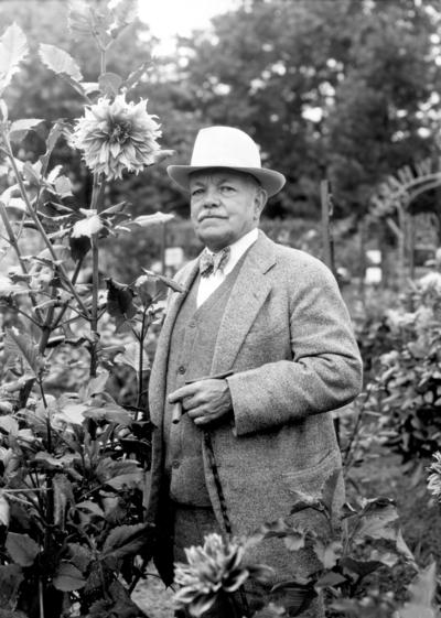 Dean F. Paul Anderson in Dahlia garden