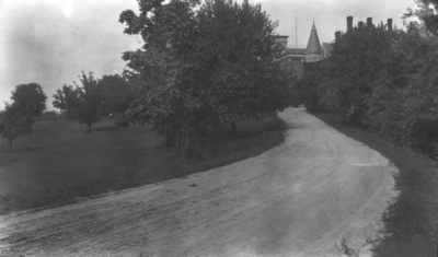 Unpaved road leading to the Administration and Gillis Buildings