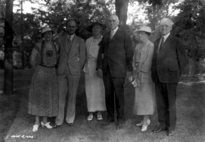 Mr. and Mrs. Richard Stoll, President and Mrs. Frank McVey and an unidentified couple