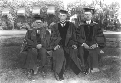 Richard Stoll in middle, Board of Trustees, and two unidentified men in Commencement gowns