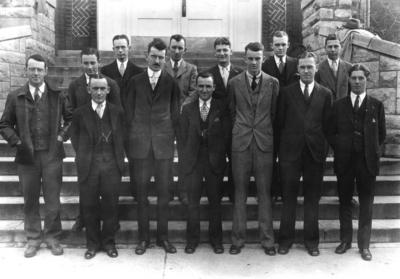 Group photograph, Sigma Gamma Epsilon, includes McFarlan, Professor of Geology and Robinson, Professor of Geology, on steps of Miller Hall, 1930 Kentuckian, p.258