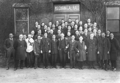 Group photograph on steps of Mechanical Hall, the original Anderson Hall, American Association of Engineers, two people with unknown position are Tom Foster, and William Kidwell