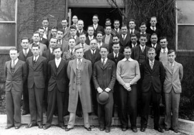 Group photograph on steps of Mechanical Hall, the original Anderson Hall, Goethals Engineering Society, includes Professor Freeman