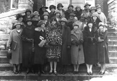 Unidentified women on steps of Miler Hall, sponsors