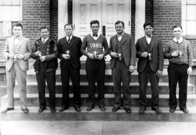 Men with trophies, intramural sports