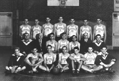 Men's varsity basketball team, Coach Adolph Rupp second row on left