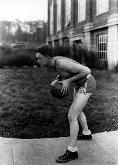 Basketball player in front of Alumni Gym
