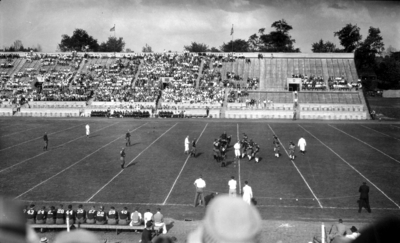 Football game, field and stands, (Stoll Field and McLean Stadium)