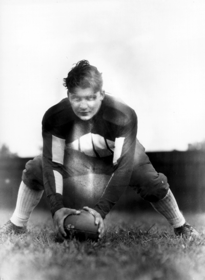 Kentucky football player, in position to snap the ball