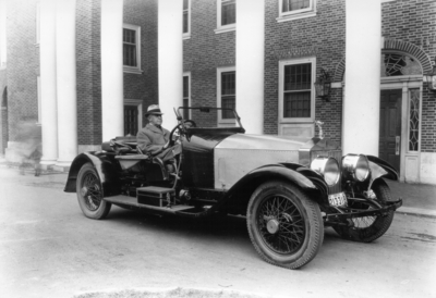 Charles H. Anderson, Professor of Engineering Design, 1919 - 1938 seated in his 1921 Rolls Royce car in front of Kinkead Hall