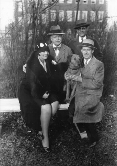 Dean F. Paul Anderson, Engineering, standing on left, two unidentified men, one unidentified woman and dog