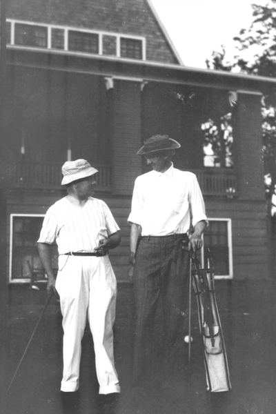 Dean F. Paul Anderson, Engineering, and unidentified man with golf clubs