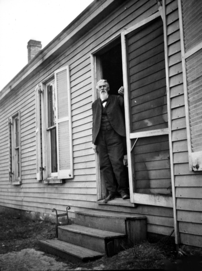 Unidentified old man looking out of doorway, Joseph Dicker Family?, superintendent of shops