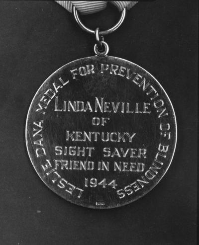 Medal for Miss Linda Neville,