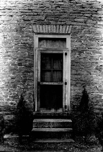 Sims estate, exterior door of stone house