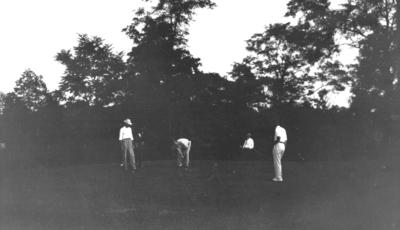 Unidentified men golfing