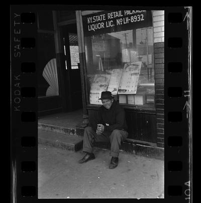 East End Real estate office, African-American man sitting