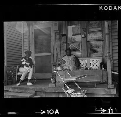 Two women on porch, Three children on porch
