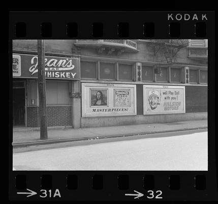 Picture showing Jean's Bar and advertisements for Pasqual's Pizza and Hillside Motors