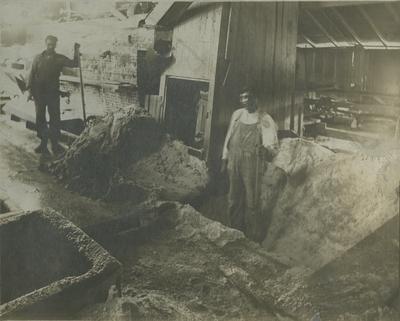 Photograph of 2 men working